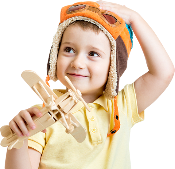 kid with wooden airplane toy